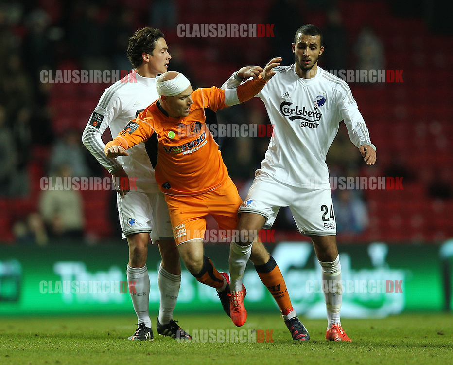 Christian Keller of Randers FC is pushed by Youssef Toutouh of FC København during the Danish DBU Pokalen Cup match between FC København and Randers FC at Telia Parken on March 5, 2015 in Copenhagen, Denmark. (Photo by Claus Birch)
