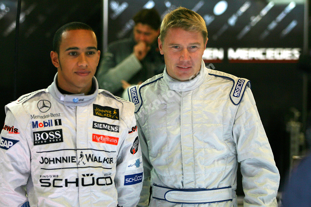 McLaren-Mercedes drivers Lewis Hamilton and Mika Hakkinen at the Circuit de Catalunya outside Barcelona on November 30 2006. Photo: XPB/Grand Prix Photo
