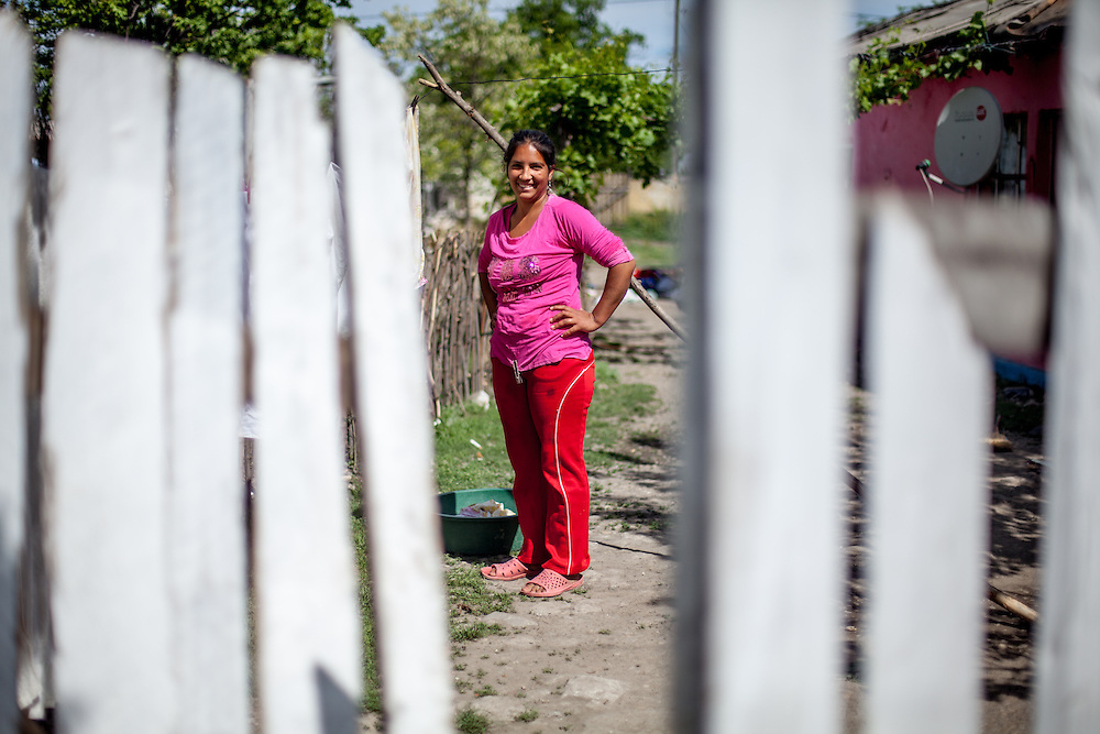 A woman in front of her house in the Roma area of Frumusani.