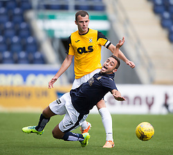 Falkirk's Tom Taiwo tackled by East Fife's Kevin Smith. Falkirk 3 v 1 East Fife, Petrofac Training Cup played 25th July 2015 at The Falkirk Stadium.