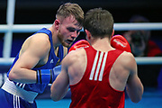 Eskerkhan Madiev of Georgia (red) and Paul Andreas Wall of Germany (bue) competing in the Men's Welterweight preliminaries during The Road to Tokyo European Olympic Boxing Qualification, Sunday, March 15, 2020, in London, United Kingdom. (Mitchell Gunn-ESPA-Images/Image of Sport)