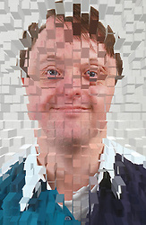 Portrait of man with Downs Syndrome smiling,