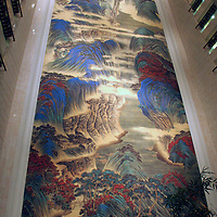 """Asia, China, Hong Kong. The world's largest Chinese silk painting, """"The Great Motherland of China"""", spanning 16 stories at the Island Shangri-La Hotel.."""