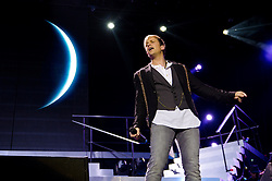 © Licensed to London News Pictures. 23/05/2012. London, UK. Westlife perform live at The O2 Arena, London, as part of their final ever farewell tour.   Westlife are an Irish boy band formed in 1998. They are to disband in 2012 after their farewell tour. The group's line-up was Shane Filan, Mark Feehily, Nicky Byrne, and Kian Egan.  In this picture - Kian Egan.  Westlife have sold over 45 million records worldwide which includes studio albums, singles, video release, and compilation albums.  Photo credit : Richard Isaac/LNP