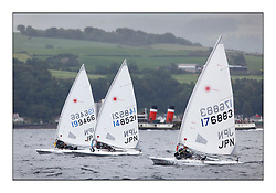 The second day of racing at the World Laser Radial Youth Championships, Largs, Scotland...The Japanese men's  team upwind with the Waverley...317 Youth Sailors from 42 different nations compete in the World and European Laser Radial Youth Champiponship from the 17-25 July 2010...The Laser Radial World Championships take place every year. This is the first time they have been held in Scotland and are part of the initiaitve to bring key world class events to Britain in the lead up to the 2012 Olympic Games. ..The Laser is the world's most popular singlehanded sailing dinghy and is sailed and raced worldwide. ..Further media information from .laserworlds@gmail.com.event press officer mobile +44 7866 571932 and +44 1475 675129 .
