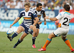 Gary van Aswegen of the DHL Stormers chips the ball with teammate Brian Habana giving chase and replacement Sias Ebersohn of the Toyota Cheetahs on defense during the Super Rugby (Super 15) fixture between the DHL Stormers and the Cheetahs held at DHL Newlands Stadium in Cape Town, South Africa on 26 February 2011. Photo by Jacques Rossouw/SPORTZPICS