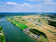 Nederland, Limburg, Gemeente Venray; 27-05-2020; Wanssum, zicht op de Maas en (toekomstige) hoogwatergeul. Op deze lokatie niet alleen de geulen maar ook de toekomstige de uitlaat. Onderdeel van Gebiedsontwikkeling Ooijen en Wanssum, waaronder aanleg van een  hoogwatergeul, weerdverlaging en natuurontwikkeling.<br /> Op het middenplan de Koninginnebrug en N270 naar Well.<br /> Wanssum, view of the Maas and (future) high water channel. At this location not only the channels but also the future outlet, on the right the construction of the Hoge Gronddijk. <br /> luchtfoto (toeslag op standard tarieven);<br /> aerial photo (additional fee required)<br /> copyright © 2020 foto/photo Siebe Swart