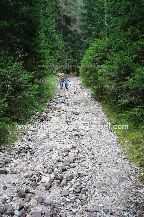Mother and youn boy on a nature trail. Photographed in the Dolomite region Italy