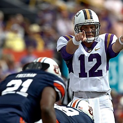 October 22, 2011; Baton Rouge, LA, USA; LSU Tigers quarterback Jarrett Lee (12) against the Auburn Tigers during the first half at Tiger Stadium.  Mandatory Credit: Derick E. Hingle-US PRESSWIRE / © Derick E. Hingle 2011