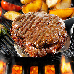 Beef fillet steaks, chips & roast p[eppers  being pan fried on a bbq. Meat food photos, pictures & images.