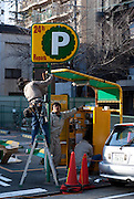 Some workers installing equipment for a new car private carpark