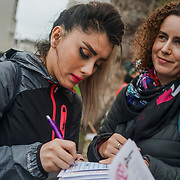 London, UK. 8th March, 2017. Iranian Amelia Assadi Kid's and Women's right activist and Volleyball player protests outside Downing Street on International Women's Day to draw attention to the disproportionate impact on women of the Government's continuing programme of austerity cuts. by See Li
