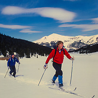 Nancy Burke & James Peterson cross country ski near Copper Mountain ski area, Colorado