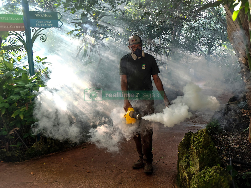 Fran Middlebrooks, a grounds keeper at Pinecrest Gardens, former home of the historic Parrot Jungle, uses a blower to spray pesticide to kill mosquitos August 4, 2016 in Miami, FL, USA, as Miami Dade county fights to control the Zika virus outbreak. There are a reported 14 individuals who have been infected with the Zika virus by local mosquitoes. Photo by Gaston De Cardenas/Miami Herald/TNS/ABACAPRESS.COM