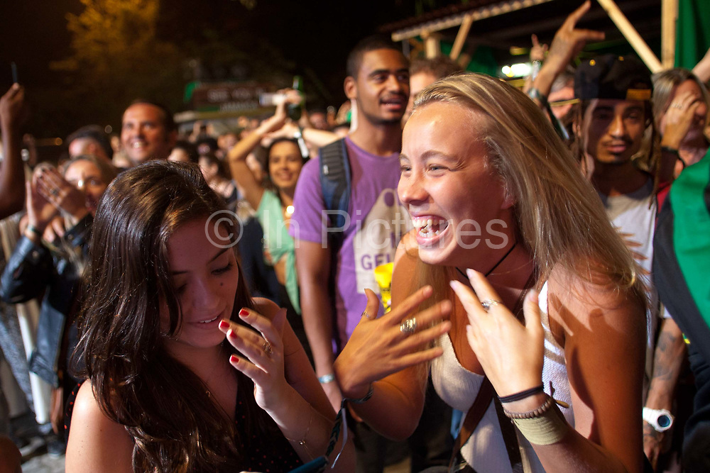 An International, Brazilian and Jamaican crowd in Jamaica House, celebrate Usain's Bolt's 200m Olympic victory, Rio 2016, Gavea Jockey Club, Rio de Janeiro. (Photo by Phil Clarke Hill/In Pictures via Getty Images)