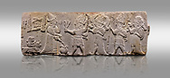 Aslantepe Hittite relief sculpted orthostat stone panel. Limestone, Aslantepe, Malatya, 1200-700 B.C. . Anatolian Civilisations Museum, Ankara, Turkey<br /> <br /> Scene of the king's offering drink and sacrifice to the gods. King pours from the pitcher to the vessel (libation); behind the king is a servant bringing a sacrifice. Storm God across the king holds Teshup, a triple lightning bundle - sickle, and a spear-mace set in the other orthostat; the goddess Ishtar holds weapon in both. All six figures have shoes with the curled ends. <br /> <br /> Against a gray background. .<br /> <br /> If you prefer to buy from our ALAMY STOCK LIBRARY page at https://www.alamy.com/portfolio/paul-williams-funkystock/hittite-art-antiquities.html . Type - Aslantepe - in LOWER SEARCH WITHIN GALLERY box. Refine search by adding background colour, place, museum etc.<br /> <br /> Visit our HITTITE PHOTO COLLECTIONS for more photos to download or buy as wall art prints https://funkystock.photoshelter.com/gallery-collection/The-Hittites-Art-Artefacts-Antiquities-Historic-Sites-Pictures-Images-of/C0000NUBSMhSc3Oo