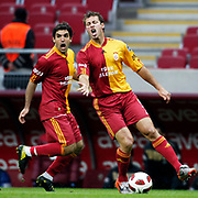 Galatasaray's Juan Emmanuel CULIO (L) and Lucas NEILL (R) during their Turkish superleague soccer derby match Galatasaray between Trabzonspor at the TT Arena in Istanbul Turkey on Sunday, 10 April 2011. Photo by TURKPIX
