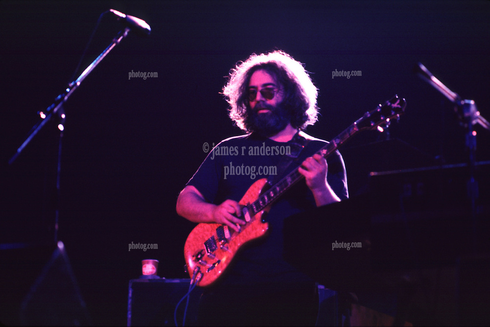 Jerry Garcia looking out over the Audience in Contemplation. The Grateful Dead in Concert at the Huntington Civic Center, Huntington West Virginia on 16 April 1978. Image No. 78C16-08