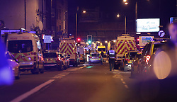 """Police officers activity at Finsbury Park in north London, where one person has been arrested after a vehicle struck pedestrians, leaving """"a number of casualties""""."""