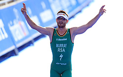South Africa's Richard Murray celebrates as he crosses the line to win the elite men's race during the 2018 ITU World Triathlon Series Event in Leeds.