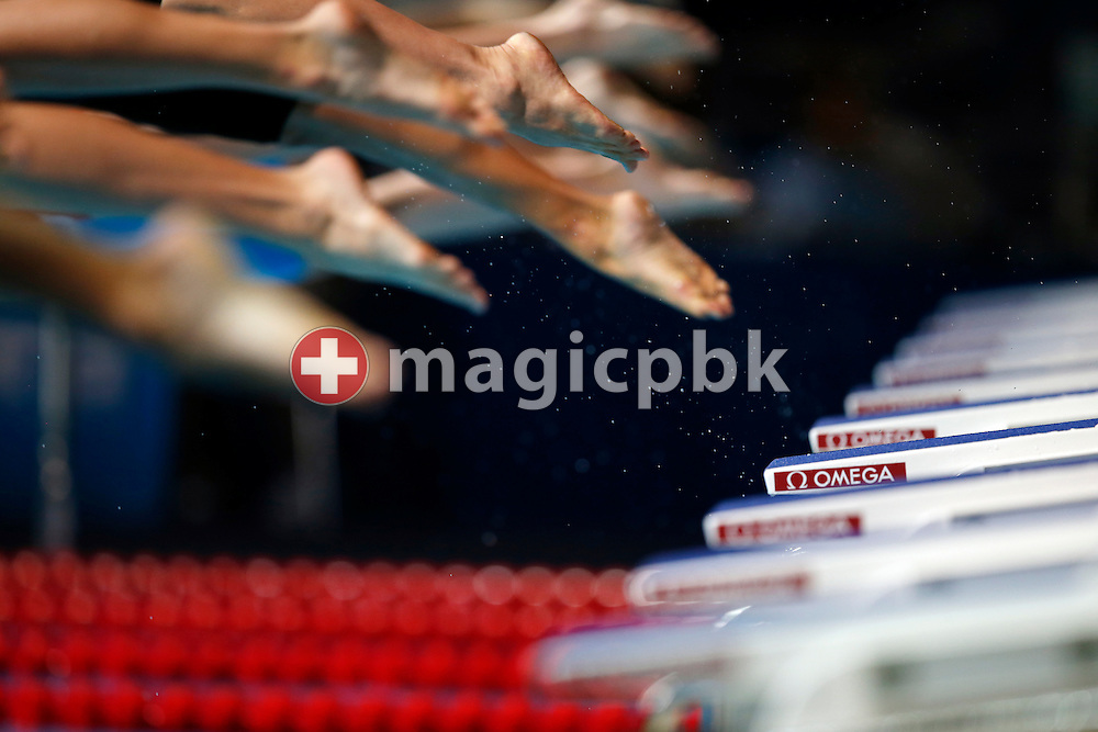 Swimmers dive of the starting blocks in the men's 800m Freestyle Heat 2 during the 15th FINA World Aquatics Championships at the Palau Sant Jordi in Barcelona, Spain, Tuesday, July 30, 2013. (Photo by Patrick B. Kraemer / MAGICPBK)