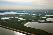 Nederland, Flevoland, Gemeente Lelystad, 27-08-2013; Oostvaardersplassen met Grote Plas en Krentenplas (li boven). Markermeer (beneden in beeld) en Oostvaardersdijk.<br /> Bird sanctuary and nature reserve Oostvaardersplassen north-east of the city of Almere,. Markermeer (lake) bottom pic.<br /> luchtfoto (toeslag op standaard tarieven);<br /> aerial photo (additional fee required);<br /> copyright foto/photo Siebe Swart.