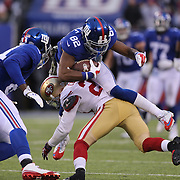 Rueben Randle, New York Giants, is tackled by Chris Culliver, San Francisco 49ers, during the New York Giants V San Francisco 49ers, NFL American Football match at MetLife Stadium, East Rutherford, NJ, USA. 16th November 2014. Photo Tim Clayton