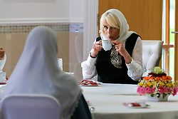 © Licensed to London News Pictures. 07/04/2021. London, UK. Camilla, Duchess of Cornwall, wearing a headscarf, has tea with the members of the Mosque during a visit to the London Islamic Cultural Society and Mosque (also known as Wightman Road Mosque) in Haringey, north London. The Mosque was formed by a small group of Guyanese Muslims and now supports over 30 different nationalities and community in Haringey and surrounding boroughs. Photo credit: Dinendra Haria/LNP