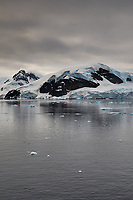 Panorama of Paradise Harbor and Brown Station (Estación Científica Almirante Brown) in Antarctica from the Deck of the Hurtigruten MS Fram. (1 of 16) Image taken with a Fuji X-T1 camera and Zeiss 32 mm f/1.8 lens (ISO 200, 32 mm, f/16, 1/500 sec). Raw images processed with Capture One Pro, Focus Magic, Photoshop CC 2015, and AutoPano Giga Pro
