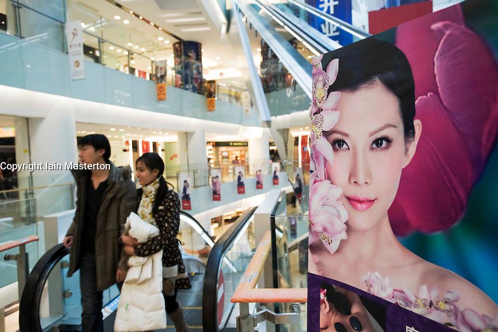 Interior of modern shopping mall at Wangfujing in central Beijing China