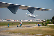 Landing at Don Muang airport in a Bangkok Airways ATR 72 coming from Siem Reap. Playing golf between the runways while an A>irbus A340 is starting in the background.