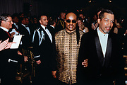 Musician Stevie Wonder is escorted by his assistant Brian LaRoda, right, during the State Dinner honoring British Prime Minister Tony Blair at the White House February 5, 1998 in Washington, DC. Wonder performed with fellow musician Elton John at the dinner.