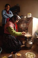 Ali Ipak 's wife Ayse and daughter Emel, (in blue) prepare lunch December 12, 2005 in central Turkey, Konya in Kutoren district, about 400 kilometers from Ankara.  (Ami Vitale)