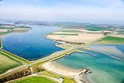 Nederland, Zeeland, Noord-Beveland, 01-04-2016; Kats. Zandkreek en Zandkreekdam met de steigers van het vroegere Katse  Veer in de voorgrond. Gezien vanuit Zuid-Beveland. In het midden van de dam de Katse Heule, inlaat van vers (zout) water vanuit de Oosterschelde (voorgrond) in het Veerse Meer.<br /> Zandkreekdam, part of the Delta Works.<br /> <br /> luchtfoto (toeslag op standard tarieven);<br /> aerial photo (additional fee required);<br /> copyright foto/photo Siebe Swart