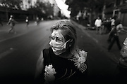 """Athens, Greece - Woman protecting herself with  a mask during a demonstration. Greek economical crisis started in 2008. The so-called Austerity measures imposed to the country by the """"Troika"""" (European Union, European Central Bank, and International Monetary Fund) to reduce its debt, were followed by a deep recession and the worsening of life conditions for millions of people. Unemployment rate grew from 8.5% in 2008 to 25% in 2012 (source: Hellenic Statistical Authority).<br /> Bruno Simões Castanheira"""