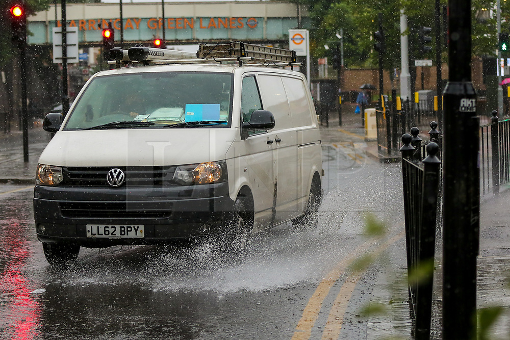 © Licensed to London News Pictures. 18/06/2021. London, UK. A van ploughs through surface flood water in north London, as wet weather conditions continue after a warm dry spell.  Photo credit: Dinendra Haria/LNP