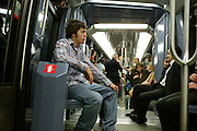 Evan Menzel on the Metro (underground) Paris, France.