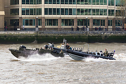 © Licensed to London News Pictures. 23/10/2018. London, UK. Royal Marines in RIB's travel on the River Thames near London Bridge as people walk past during a rehearsal for a display tomorrow when the Royal Marines and Royal Netherlands Marines will stage a joint on water capability demonstration with blank ammunition. As part of the Dutch state visit, King Willem-Alexander and Queen Máxima will attend the Dutch ship HNLMS Zeeland, which is anchored next to HMS Belfast. They will join The Duke of Kent on board and will be given a 10 minute display of the Royal Marines and Royal Netherlands Marines staging a joint on water capability demonstration.Photo credit: Vickie Flores/LNP