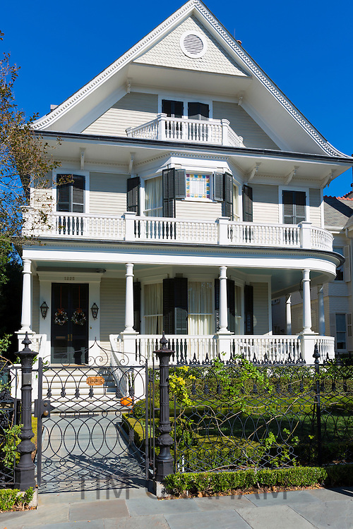 Traditional grand mansion house with double gallery and columns in the Garden District of New Orleans, Louisiana, USA