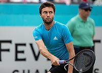 Tennis - 2019 Queen's Club Fever-Tree Championships - Day Seven, Sunday<br /> <br /> Men's Singles Final: Feliciano Lopez (ESP) Vs. Gilles Simon (FRA)<br /> <br /> Gilles Simon (FRA) watches as his shot flies away on Centre Court.<br />  <br /> COLORSPORT/DANIEL BEARHAM