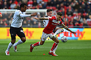 Harry Wilson (7) of Derby County challenged Jamie Paterson (20) of Bristol City during the EFL Sky Bet Championship match between Bristol City and Derby County at Ashton Gate, Bristol, England on 27 April 2019.