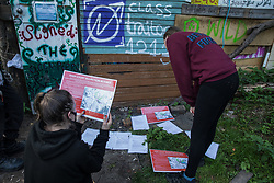 Anti-HS2 activists glance at legal documents served by bailiffs and officials in connection with an extended injunction recently granted to HS2 Ltd by the High Court to persons believed to be former inhabitants of a wildlife protection camp occupied by anti-HS2 activists on 21 September 2020 in Denham, United Kingdom. Anti-HS2 activists continue to try to prevent or delay works for the controversial £106bn HS2 high-speed rail link on environmental and cost grounds from a series of protection camps based along the route of the line between London and Birmingham.