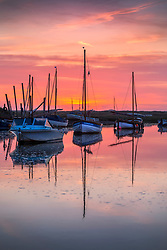 © Licensed to London News Pictures. 01/07/2018. The sun sets on the boats in Blakeney Quay last night on the Norfolk coast as the UK heatwave continues. Photo credit: Andrew McCaren/LNP