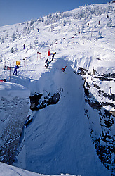 extreme skier drops into Corbet's Couloir at Jackson Hole Mountain Resort