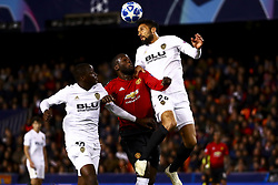December 12, 2018 - Valencia, Spain - Mouctar Diakhaby of Valencia CF (L) Romelu Lukaku of Manchester United  (C) and Ezequiel Garay of Valencia CF (R)  during UEFA Champions League Group H between Valencia CF and Manchester United at Mestalla stadium  on December 12, 2018. (Photo by Jose Miguel Fernandez/NurPhoto) (Credit Image: © Jose Miguel Fernandez/NurPhoto via ZUMA Press)
