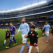 Andrea Pirlo, NYCFC, heads onto the pitch with the teams before the start of  the New York City FC Vs Orlando City, MSL regular season football match at Yankee Stadium, The Bronx, New York,  USA. 18th March 2016. Photo Tim Clayton