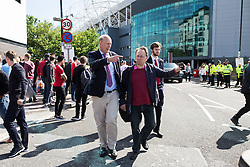 © Licensed to London News Pictures. 15/05/2016. Manchester, UK. CHRIS GRAYLING MP and MICHAEL CRICK leaving the stadium . The scene where part of Old Trafford Stadium has been evacuated before Manchester United's final-day match against Bournemouth, due to a suspect package being found. Photo credit: Joel Goodman/LNP