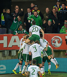 CARDIFF, WALES - Monday, October 9, 2017: Republic of Ireland James McClean is congratulated by his teammates after scoring the opening goal during the 2018 FIFA World Cup Qualifying Group D match between Wales and Republic of Ireland at the Cardiff City Stadium. (Pic by Peter Powell/Propaganda)