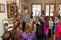 Walt Stockwell describes the job of the Storekeeper during colonial times in the Grange store during Gilford Elementary School's 4th grade Colonial Life and Tradesman walking field trip on Thursday morning.  (Karen Bobotas/for the Laconia Daily Sun)