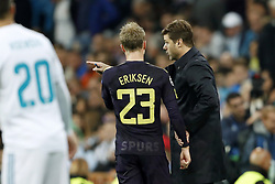 (L-R) Christian Eriksen of Tottenham Hotspur FC, coach Mauricio Pochettino of Tottenham Hotspur FC during the UEFA Champions League group H match between Real Madrid and Tottenham Hotspur on October 17, 2017 at the Santiago Bernabeu stadium in Madrid, Spain.
